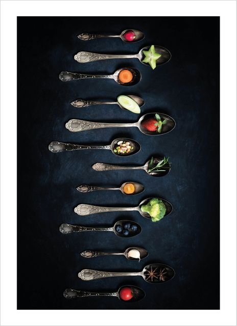 Veggies and fruits in spoons