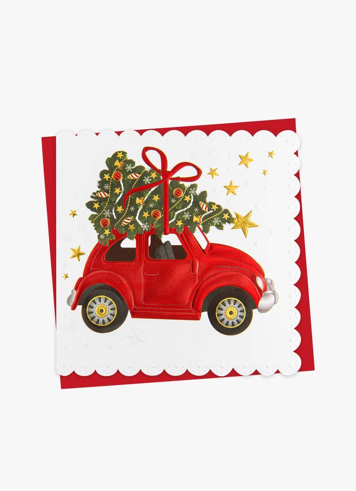 En bil kommer lastad julkort