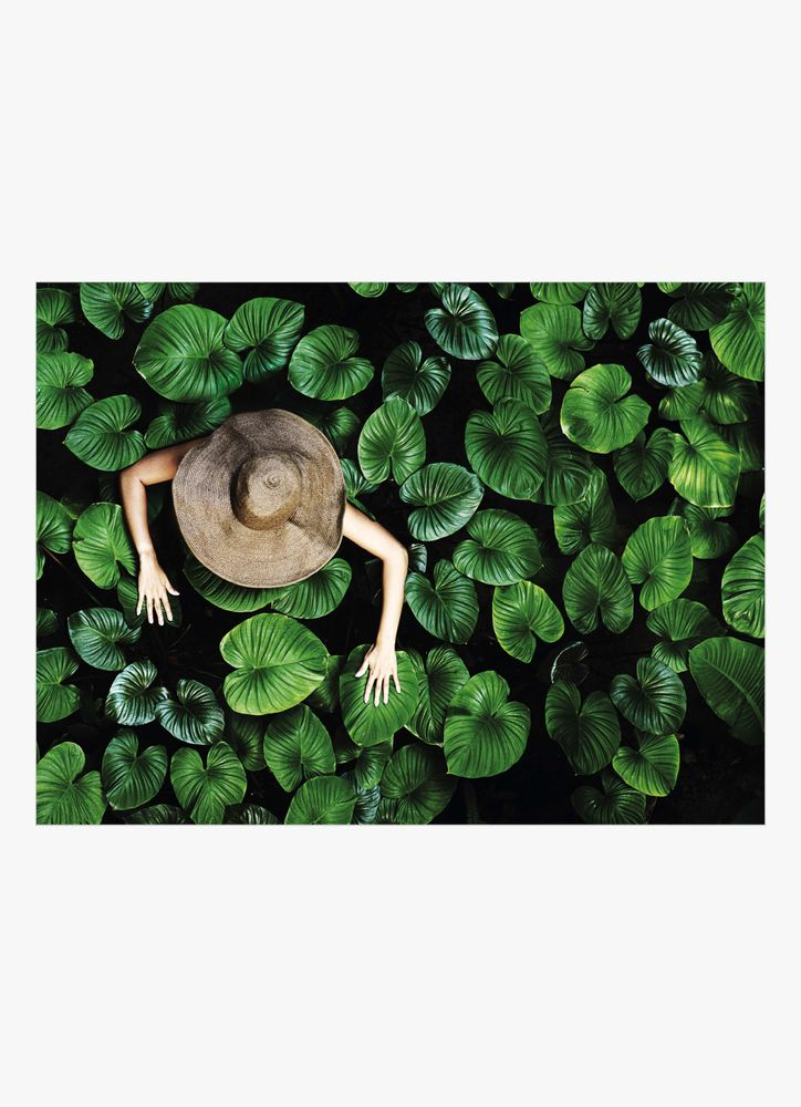 Woman with tropical leaves